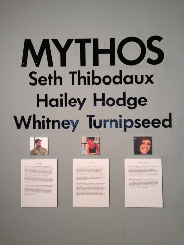 Title wall for the exhibition, Mythos, which features the work of three graduating MFA students of the University of Mississippi