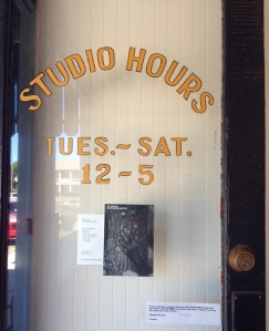 A hand-painted sign by William Warren decorates the door of Yalo Studio & Gallery.