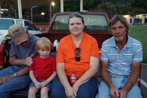 Art Crawl tailgaters Danny Rodgers, Jason Green, Sherry Green, and John Green enjoy Main Street in Water Valley.