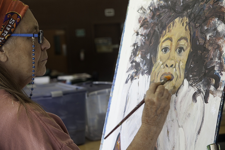 Patt Odom paints during Mississippi Art Colony, fall 2015 at Henry S. Jacob Camp, Utica, Mississippi.