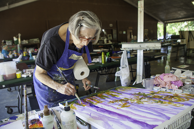 Norma Seward paints at Mississippi Art Colony in September 2015.